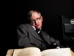 hawking_with_newtons_copy_of_principia_mathematica_please_credit_graham_copekoga